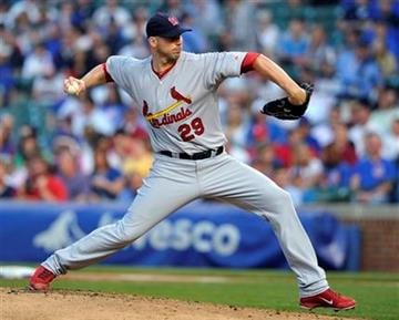 St. Louis Cardinals' Chris Carpenter pitches against the Chicago Cubs during the first inning of a baseball game Tuesday, May 10, 2011, in Chicago. (AP Photo/Jim Prisching) By Jim Prisching