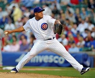 Chicago Cubs starting pitcher Carlos Zambrano pitches throws to the St. Louis Cardinals during the first inning of a baseball game Tuesday, May 10, 2011, in Chicago. (AP Photo/Jim Prisching) By Jim Prisching
