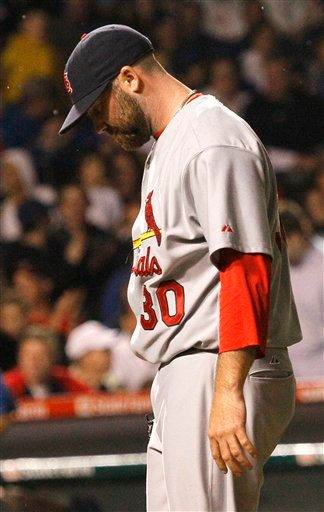 St. Louis Cardinals relief pitcher Jason Motte walks to the dugout after the third inning of a baseball game against the Chicago Cubs Wednesday, May 11, 2011 in Chicago. (AP Photo/Charles Rex Arbogast) By Charles Rex Arbogast