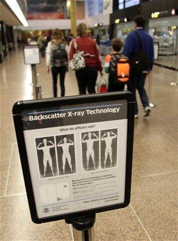Passengers walk past a sign informing travelers about the use of full-body scanners for TSA security screening, Friday, Nov. 19, 2010, at Seattle-Tacoma International Airport in Seattle. (AP Photo/Ted S. Warren) By Ted S. Warren