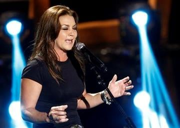 Gretchen Wilson performs during the CMT Disaster Relief Concert Thursday, May 12, 2011 in Nashville, Tenn.  Proceeds from the concert will help victims of recent tornadoes. (AP Photo/Wade Payne) By Wade Payne