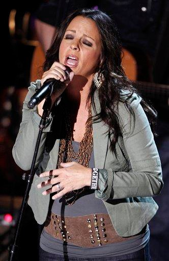 Sara Evans performs during the CMT Disaster Relief Concert Thursday, May 12, 2011 in Nashville, Tenn.  Proceeds from the concert will help victims of recent tornadoes. (AP Photo/Wade Payne) By Wade Payne