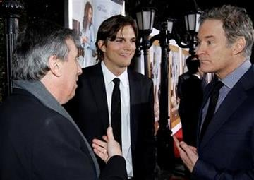 """Cast members Ashton Kutcher, center, Kevin Kline, right, and director Ivan Reitman speak to each other at the premiere """"No Strings Attached"""" in Los Angeles, on Tuesday, Jan. 11, 2011.  (AP Photo/Matt Sayles) By Matt Sayles"""