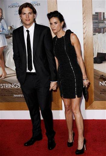 """Cast member Ashton Kutcher, left, and Demi Moore arrive at the premiere """"No Strings Attached"""" in Los Angeles, on Tuesday, Jan. 11, 2011.  (AP Photo/Matt Sayles) By Matt Sayles"""