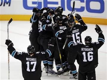 San Jose Sharks celebrate after defeating the Detroit Red Wings 3-2 in Game 7 of an NHL hockey Stanley Cup Western Conference semifinal playoff series Thursday, May 12, 2011, in San Jose, Calif. (AP Photo/Paul Sakuma) By Paul Sakuma