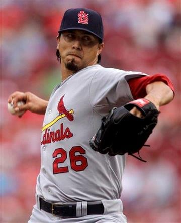St. Louis Cardinals starting pitcher Kyle Lohse throws against the Cincinnati Reds during the first inning of a baseball game, Friday, May 13, 2011, in Cincinnati. (AP Photo/Al Behrman) By Al Behrman
