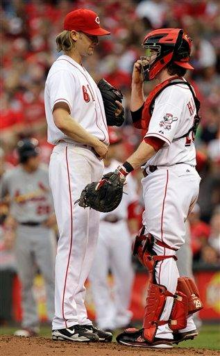 Cincinnati Reds starting pitcher Bronson Arroyo (61) talks with catcher Ryan Hanigan in the fourth inning of a baseball game against the St. Louis Cardinals, Friday, May 13, 2011, in Cincinnati. (AP Photo/Al Behrman) By Al Behrman
