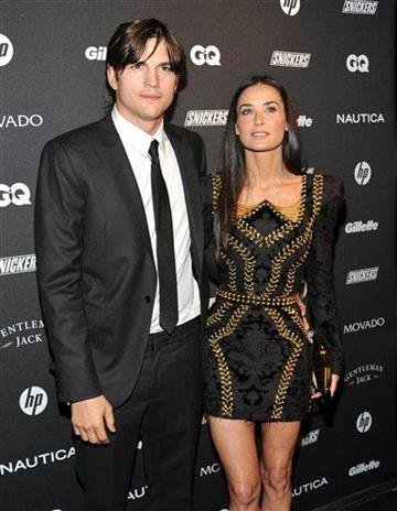 FILE - Oct. 27, 2010 file photo, actors Ashton Kutcher, left, and wife Demi Moore attend The Gentleman's Ball hosted by GQ Magazine in New York. (AP Photo/Evan Agostini, file) By Evan Agostini