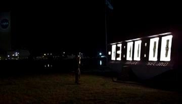 A photographer takes a picture of the countdown clock before the space shuttle Endeavour lifts off from Kennedy Space Center in Cape Canaveral, Fla., Monday, May 16, 2011. (AP Photo/Tim Donnelly) By Tim Donnelly