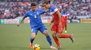 SAN FRANCISCO, CA - MAY 27:  Graham Zusi #19 of the United States and Gara Garayev #8 of  Azerbaijan go for the ball during their match at Candlestick Park on May 27, 2014 in San Francisco, California.  (Photo by Ezra Shaw/Getty Images) By Ezra Shaw
