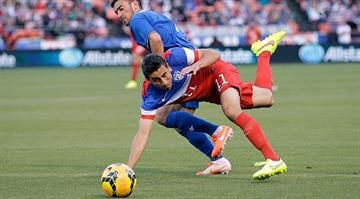 SAN FRANCISCO, CA - MAY 27:  Alejandro Bedoya #11 of the United States and Gara Garayev #8 of  Azerbaijan go for the ball during their match at Candlestick Park on May 27, 2014 in San Francisco, California.  (Photo by Ezra Shaw/Getty Images) By Ezra Shaw