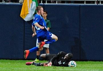 ST. LOUIS, MO - MAY 30: Edin Visca #19 of Bosnia-Herzegovina leaps over Slyvain Gbouhouo #16 of the Ivory Coast during the first half at Edward Jones Dome on May 30, 2014 in St. Louis, Missouri.  (Photo by Jeff Curry/Getty Images) By Jeff Curry