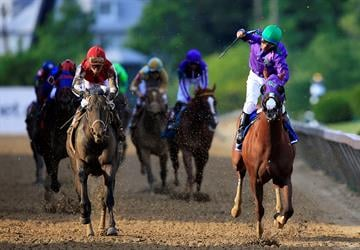 BALTIMORE, MD - MAY 17:  California Chrome #3, ridden by Victor Espinoza, crosses the finishline to win the 139th running of the Preakness Stakes at Pimlico Race Course on May 17, 2014 in Baltimore, Maryland.  (Photo by Rob Carr/Getty Images) By Rob Carr