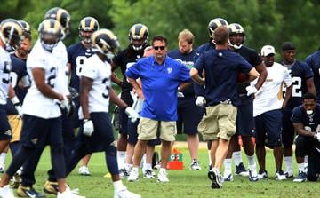 St. Louis Rams head football coach Jeff Fisher watches his players during the first day of organized team activities at Rams Park in Earth City, Missouri on June 5, 2014.    UPI/Bill Greenblatt By BILL GREENBLATT