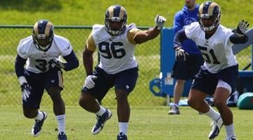 EARTH CITY, MO - MAY 16: Michael Sam #96, Maurice Alexander #31and Aaron Hill #51 of the St. Louis Rams participate in a rookie minicamp at Rams Park on May 16, 2014 in Earth City, Missouri.  (Photo by Dilip Vishwanat/Getty Images) By Dilip Vishwanat