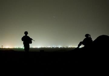 Soldiers from the 3rd Platoon, Delta Coy, 1-64 Armoured Batallion of the US Army operating under NATO mount an night-time operating post at Devils hill on September 6, 2012 near the Kandahar Air Field. By TONY KARUMBA