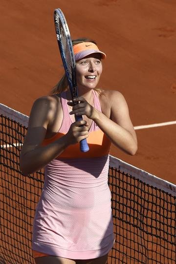 Sharapova won her second title at Roland Garros in the last three years, overcoming 12 double-faults Saturday to beat fourth-seeded Simona Halep 6-4, 6-7 (5), 6-4 in the final. By DOMINIQUE FAGET