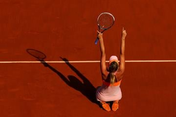 Sharapova won her second title at Roland Garros in the last three years, overcoming 12 double-faults Saturday to beat fourth-seeded Simona Halep 6-4, 6-7 (5), 6-4 in the final. By Clive Brunskill