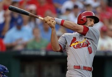 KANSAS CITY, MO - JUNE 5:  Matt Carpenter #13 of the St. Louis Cardinals hits a RBI single in the fourth inning against the Kansas City Royals at Kauffman Stadium on June 5, 2014 in Kansas City, Missouri. (Photo by Ed Zurga/Getty Images) By Ed Zurga