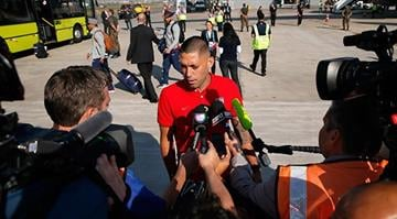 SAO PAULO, BRAZIL - JUNE 09:  Clint Dempsey of the United States is interviewed by media after arriving at Sao Paulo International Airport on June 9, 2014 in Sao Paulo, Brazil.  (Photo by Kevin C. Cox/Getty Images) By Kevin C. Cox