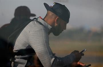 SAO PAULO, BRAZIL - JUNE 09:  Goalkeeper Tim Howard of the United States sits on a bus to the terminal after arriving at Sao Paulo International Airport on June 9, 2014 in Sao Paulo, Brazil.  (Photo by Kevin C. Cox/Getty Images) By Kevin C. Cox