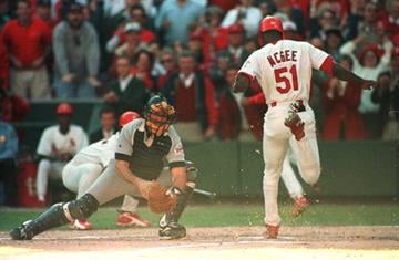 3 Oct 1996: Runner Willie McGee of the St. Louis Cardinals scores past catcher John Flaherty of the San Diego Padres in game 2 of the National League Divisional Playoffs at Busch Stadium in St Louis, Missouri. By Jonathan Daniel
