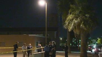 Phoenix police gather near Mother of Mercy Mission Catholic Church where a priest was shot to death and another badly injured Wednesday night. (Source: CBS 5 News) By Brendan Marks