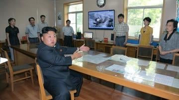 """A photo published by Rodong Sinmum reportedly shows Kim Jong Un giving """"field guidance"""" to meteorological staff. By Daniel Fredman"""