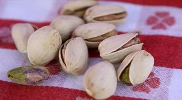 How nuts can save your life.  Researchers find that people who eat them daily lower their risk of death from heart disease and cancer. By Justin Sullivan