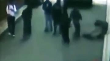 """An image captured by a security camera of a person being hit on the street in the so-called """"knockout game."""" YOUTUBE By Brendan Marks"""