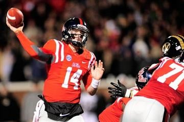 OXFORD, MS - NOVEMBER 23:  Bo Wallace #14 of the Ole Miss Rebels drops back to pass against the Missouri Tigers during a game at Vaught-Hemingway Stadium on November 23, 2013 in Oxford, Mississippi.  (Photo by Stacy Revere/Getty Images) By Stacy Revere