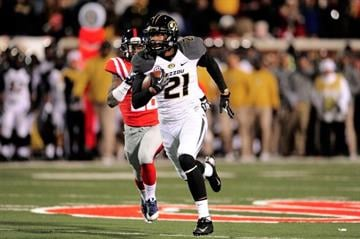 OXFORD, MS - NOVEMBER 23:  Bud Sasser #21 of the Missouri Tigers runs for yards against the Ole Miss Rebels during a game at Vaught-Hemingway Stadium on November 23, 2013 in Oxford, Mississippi.  (Photo by Stacy Revere/Getty Images) By Stacy Revere