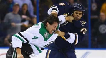 ST. LOUIS, MO - NOVEMBER 23: Ryan Reaves #75 of the St. Louis Blues punches Brenden Dillon #4 of the Dallas Stars at the Scottrade Center on November 23, 2013 in St. Louis, Missouri. (Photo by Dilip Vishwanat/Getty Images) By Dilip Vishwanat