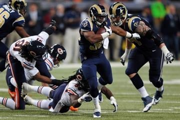 ST. LOUIS, MO - NOVEMBER 24: Benny Cunningham #36 of the St. Louis Rams rushes in the third quarter against the Chicago Bears at the Edward Jones Dome on November 24, 2013 in St. Louis, Missouri.  (Photo by Michael Thomas/Getty Images) By Michael Thomas