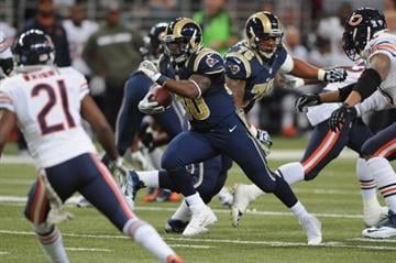 ST. LOUIS, MO - NOVEMBER 24: Zac Stacy #30 of the St. Louis Rams rushes against the Chicago Bears in the second quarter at the Edward Jones Dome on November 24, 2013 in St. Louis, Missouri.  (Photo by Michael Thomas/Getty Images) By Michael Thomas
