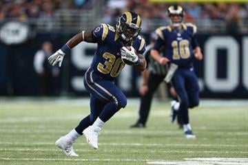 ST. LOUIS, MO - NOVEMBER 24: Zac Stacy #30 of the St. Louis Rams rushes against the Chicago Bears at the Edward Jones Dome on November 24, 2013 in St. Louis, Missouri.  (Photo by Dilip Vishwanat/Getty Images) By Dilip Vishwanat
