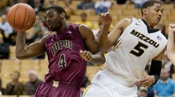 Missouri's Jordan Clarkson, right, fouls IUPUI's Ian Chiles as they vie for a rebound during the second half of an NCAA college basketball game Monday, Nov. 25, 2013, in Columbia, Mo. Missouri won 78-64. (AP Photo/L.G. Patterson) By L.G. Patterson