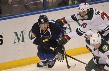St. Louis Blues Derek Roy (12) is forced to the ice by Minnesota Wild Ryan Suter in the first period at the Scottrade Center in St. Louis on November 25, 2013. UPI/Bill Greenblatt By BILL GREENBLATT