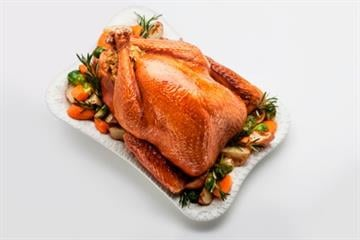 Roast stuffed chicken with vegetables By Image Source/Cadalpe
