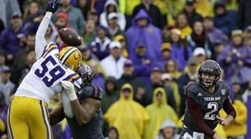 LSU defensive end Jermauria Rasco (59) bats down a pass by Texas A&M quarterback Johnny Manziel (2) in the first half of an NCAA college football game in Baton Rouge, La., Saturday, Nov. 23, 2013. (AP Photo/Gerald Herbert) By Gerald Herbert