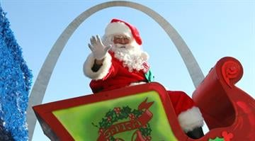 Santa Claus waves to the crowds as he passes the Gateway Arch during the Christmas in St. Louis Parade through the streets of downtown St. Louis on November 28, 2013. UPI/Bill Greenblatt By BILL GREENBLATT