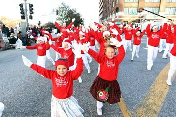 Young dancers from the Professional Dance Clinic preform  their routine as they march in the Christmas in St. Louis Parade through the streets of downtown St. Louis on November 28, 2013. UPI/Bill Greenblatt By BILL GREENBLATT