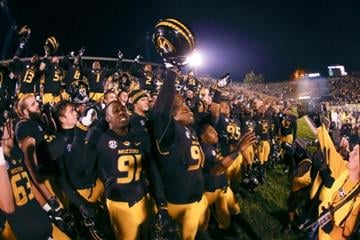 COLUMBIA, MO - NOVEMBER 2: Missouri Tigers players gather by their fans for a fight song after defeating the Tennessee Volunteers on November 2, 2013 at Faurot Field/Memorial Stadium in Columbia, Missouri. (Photo by Kyle Rivas/Getty Images) By Kyle Rivas