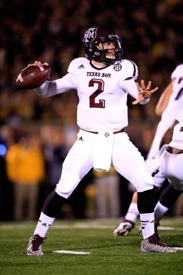 COLUMBIA, MO - NOVEMBER 30:  Quarterback Johnny Manziel #2 of the Texas A&M Aggies passes during the game against the Missouri Tigers on November 30, 2013 in Columbia, Missouri.  (Photo by Jamie Squire/Getty Images) By Jamie Squire