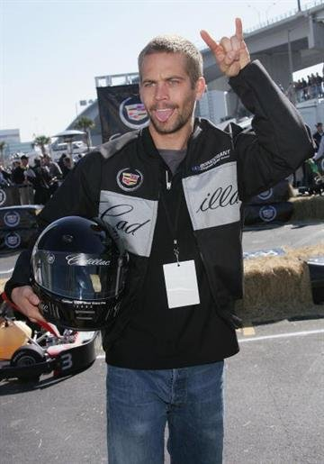 JACKSONVILLE, FL - FEBRUARY 05:  Actor Paul Walker cheers after racing in the 3rd Annual Cadillac Super Bowl Grand Prix at the CSX Parking Lot on February 5, 2005 in Jacksonville, Florida.  (Photo by Evan Agostini/Getty Images) By Evan Agostini