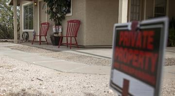 This photo shows the exterior of the Richter home on Wednesday, Nov. 27, 2013 in Tucson, Ariz. Police say three sisters were imprisoned in the home for two years by their mother and stepfather. By Brendan Marks