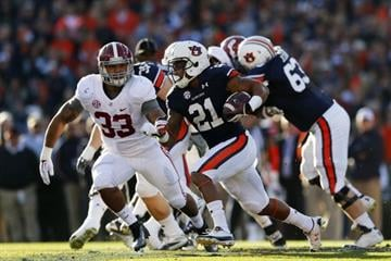 AUBURN, AL - NOVEMBER 30:  Tre Mason #21 of the Auburn Tigers carries the ball against the Alabama Crimson Tide in the first quarter at Jordan-Hare Stadium on November 30, 2013 in Auburn, Alabama.  (Photo by Kevin C. Cox/Getty Images) By Kevin C. Cox