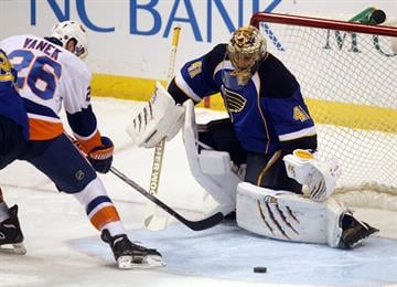 St. Louis Blues goaltender Jaroslav Halak of Slovakia kicks the puck away after a shot on goal by New York Islanders Thomas Vanek in the first period at the Scottrade Center in St. Louis on December 5, 2013. UPI/Bill Greenblatt By BILL GREENBLATT