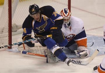 New York Islanders goaltender Anders Nilsson of Sweden pushes St. Louis Blues T.J. Oshie away from the front of the goal in the first period at the Scottrade Center in St. Louis on December 5, 2013. UPI/Bill Greenblatt By BILL GREENBLATT