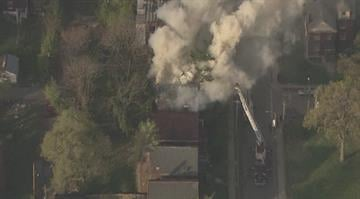 Firefighters battled a blaze that broke out in a north St. Louis neighborhood Wednesday morning. By Brendan Marks